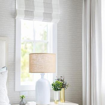Gray Stripe Roman Shade Over Tan Wood Nightstand