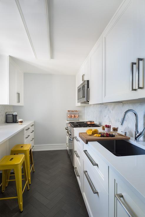 White Galley Style Kitchen With Black Herringbone Pattern Floor