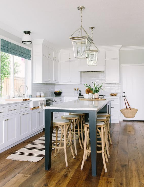 Long Black Center Island With 6 Backless Stools