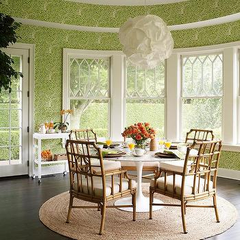 Round Green Dining Room With Rattan Chairs