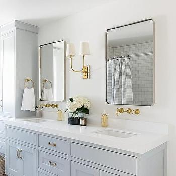 Light Gray Dual Bath Vanity with Vintage Brass Faucets