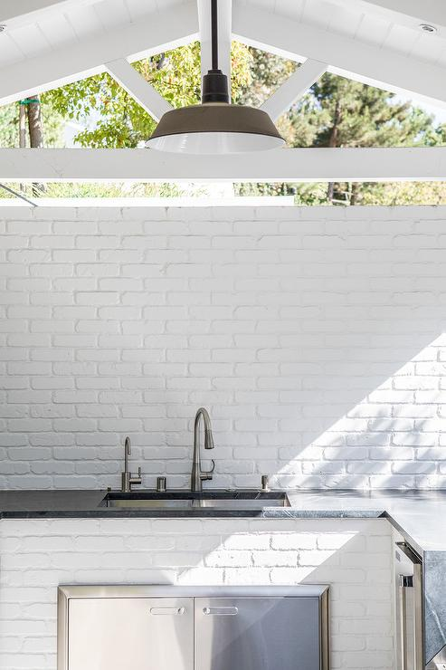 Covered Outdoor Kitchen With White Brick Walls Transitional Deck