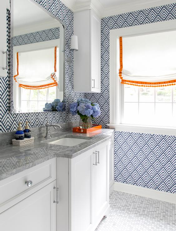 White Bathroom With Blue And Orange Accents