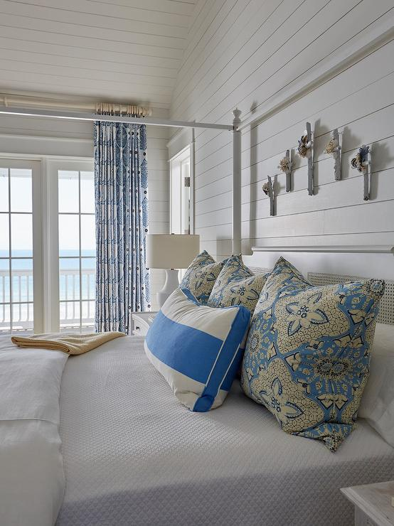Blue Shiplap Wall With Black Iron Bed Transitional Bedroom