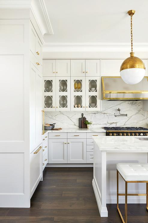 Black French Range With Silver And Gold Range Hood