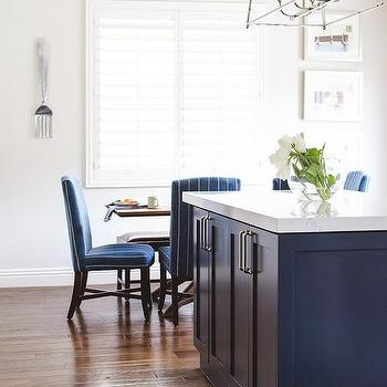 Blue Upholstered Dining Chairs At Brown Wood Dining Table