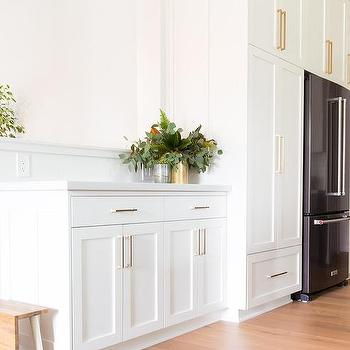 Delicieux Black Refrigerator Surrounded With White Shaker Cabinets