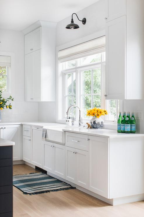 White Shaker Cabinets And Farm Sink With Black Vintage Sconce Transitional Kitchen