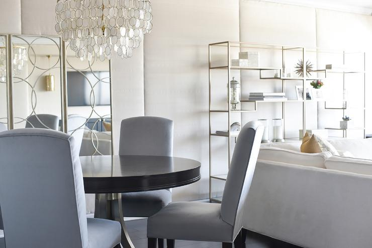 Swell Gray Upholstered Chairs At Round Black Dining Table Interior Design Ideas Philsoteloinfo