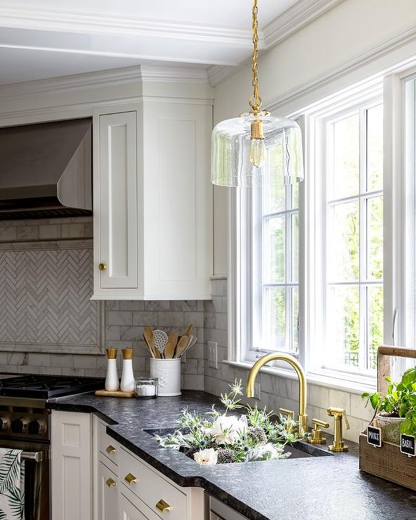 Brass and Glass Lights Over Kitchen Sink - Transitional ...