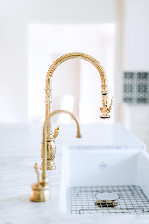 Antique Brass Gooseneck Faucet On Farm Sink Transitional Kitchen