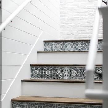 Stained Staircase Treads With Blue Tiled Risers
