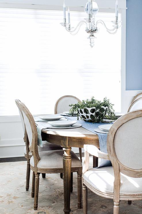 Blue Dining Room With White And Brown Round Back Dining Chairs