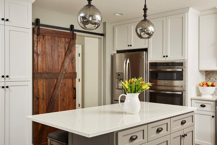 Rustic Barn Door On Rails To Kitchen Transitional Kitchen