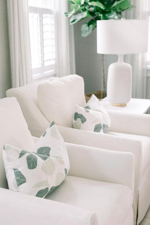 White Accent Chairs with White and Green Leaf Print Pillows ...