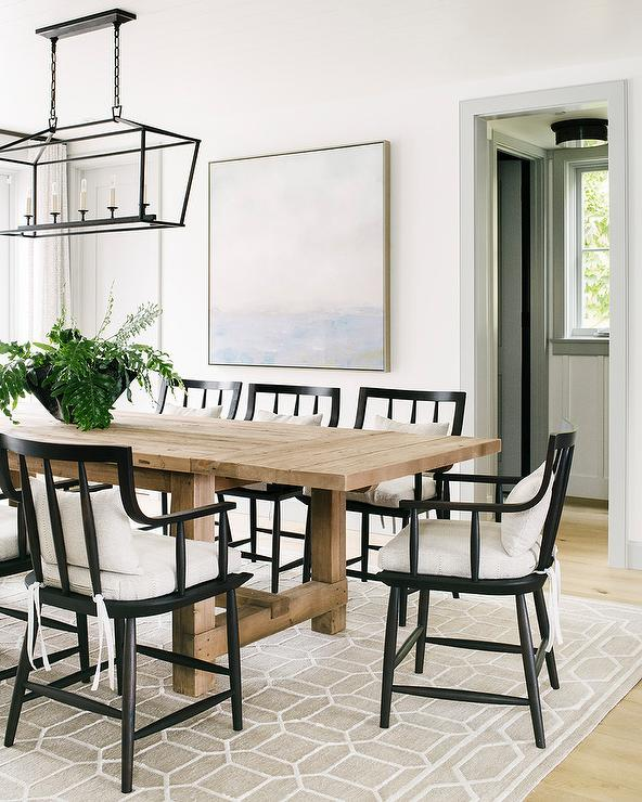 Beige Wood Plank Dining Table With Black Wooden Chairs