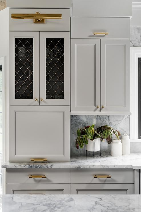 Light Gray Kitchen Cabinets With Brass Grille Doors Transitional Kitchen
