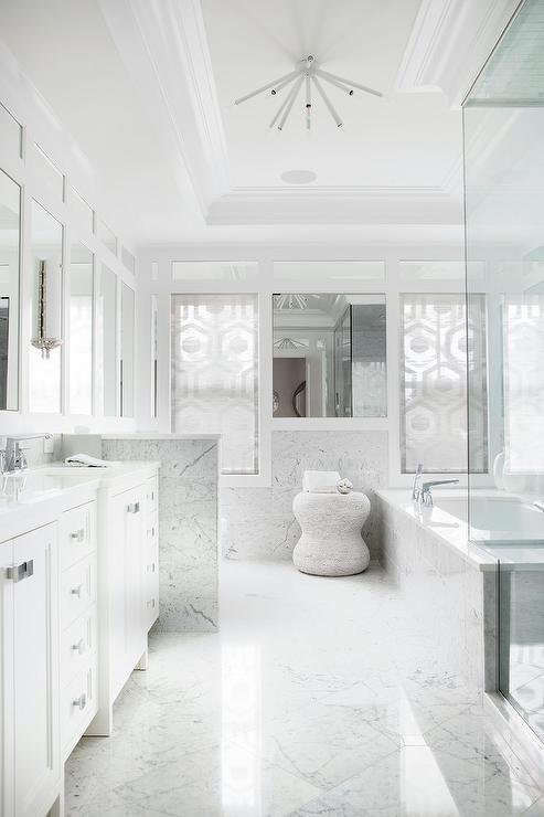 White Marble Master Bath With White Sputnik Chandelier