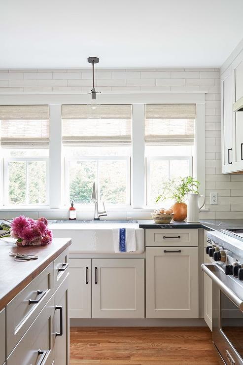 Light Gray Shaker Cabinets With Black Marble Countertops