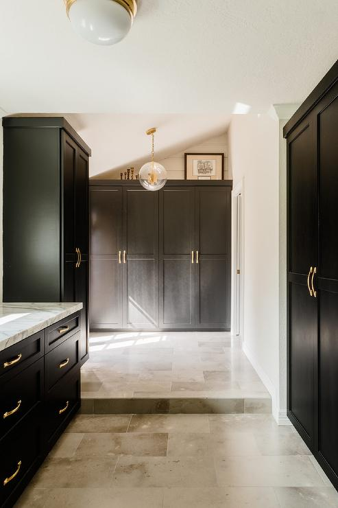 Gray Black Kitchen Cabinets With Shiny Brass Knobs