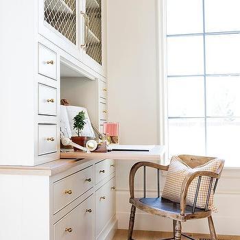 Drop Down Desk Under Brass Grille Cabinets
