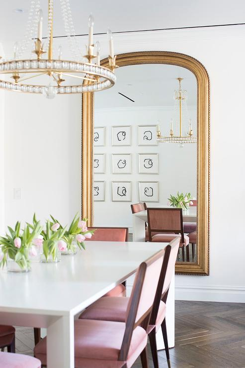 White And Pink Dining Room With Gold Leaf Arch Mirror Contemporary Dining Room