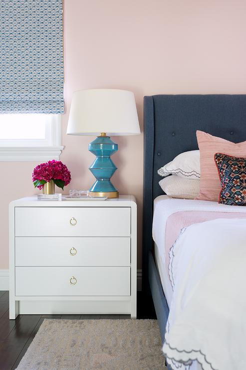 Dark Blue Wingback Bed on Pink Wall - Contemporary - Bedroom