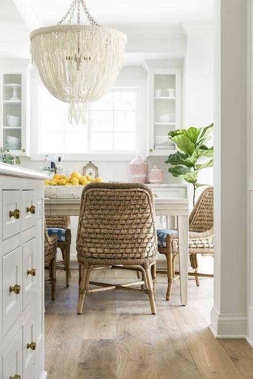 Natural Woven Dining Chairs At Light Gray Wooden Table Transitional Dining Room