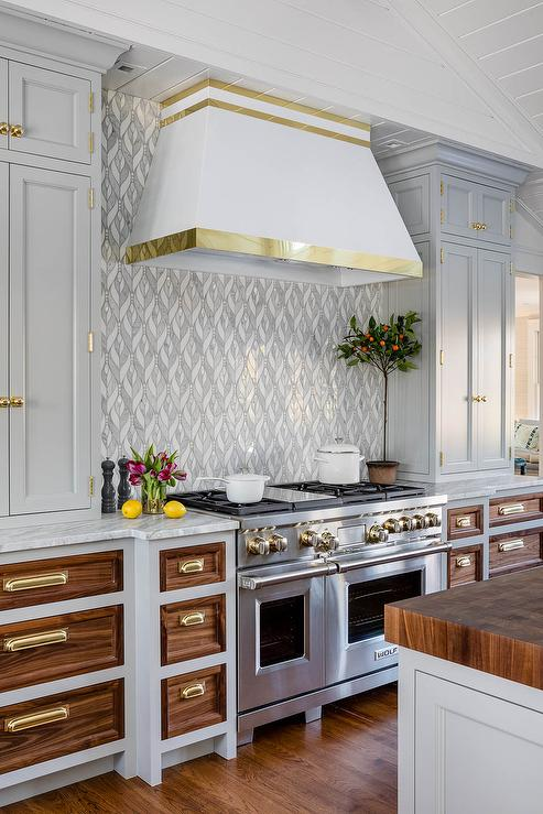 White Range Hood With Polished Brass Trim Transitional