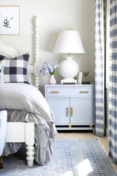 French Canopy Bed With White Ruffled Sheer Curtains