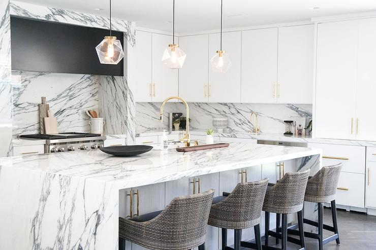 White and Gray marble waterfall island Countertop with Glass Lights -  Transitional - Kitchen