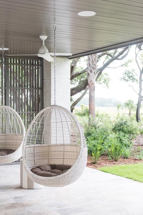 Light Gray Wicker Hanging Pod Chairs In Covered Patio Transitional Deck Patio