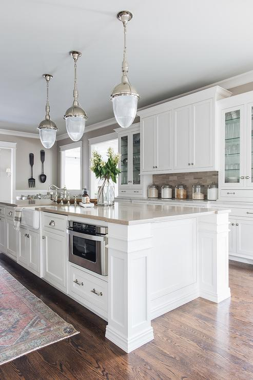 White and Beige Kitchen with Vintage Light Pendants ...