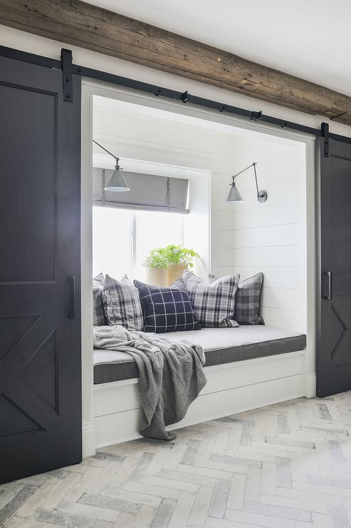 window seat pillows window sill white and gray herringbone pavers lead to white builtin shiplap window seat accented with cushion topped blue plaid pillows lit heather gray window seat cushion design ideas