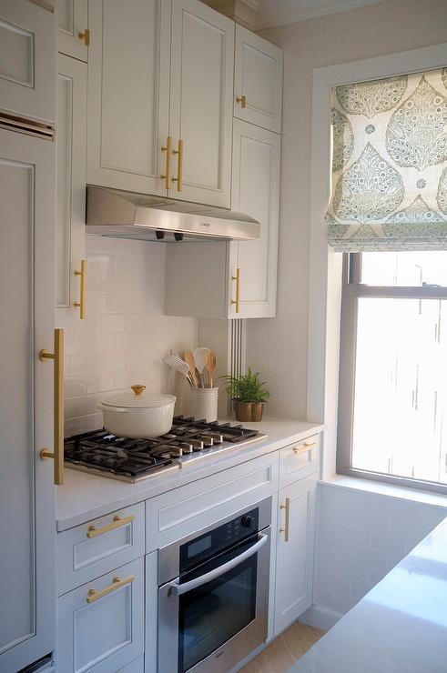 Small City Kitchen With White Cabinets And Brushed Gold Pulls Transitional Kitchen