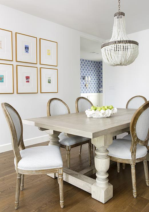 White Beaded Chandelier Over Gray Wood Dining Table ...