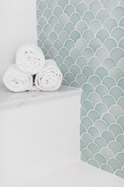 White Herringbone Tiles On Wall Behind Oval Bathtub