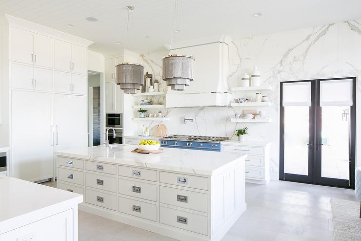 White Apothecary Style Kitchen Island With Gray Chandeliers