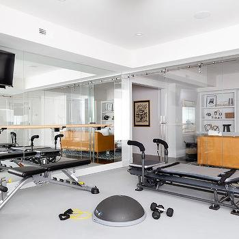 basement home gym with glass door  contemporary  basement