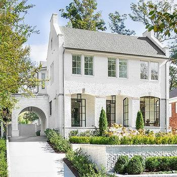 White Brick Home With Gray Roof Shingles