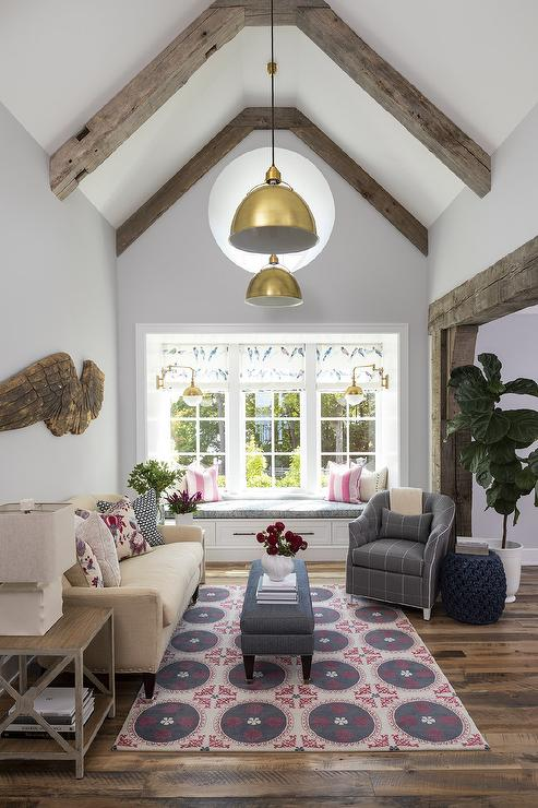 Cabin Style Vaulted Ceiling with Brass Lights - Country - Living Room