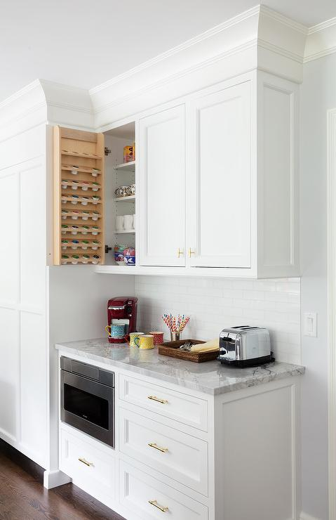 Kitchen Cabinet Fitted With Coffee Pod Shelves Transitional