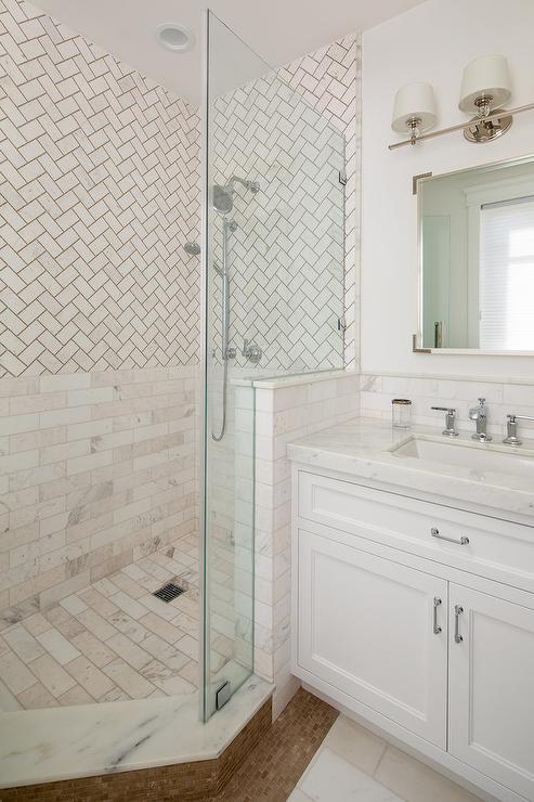 Corner Shower With White Herringbone Subway Tiles