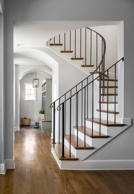 Wood And Iron Staircase With A Gray Moroccan Stair Runner