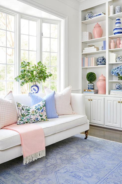 Pastel Pink and Blue Accents in White Living Room ...