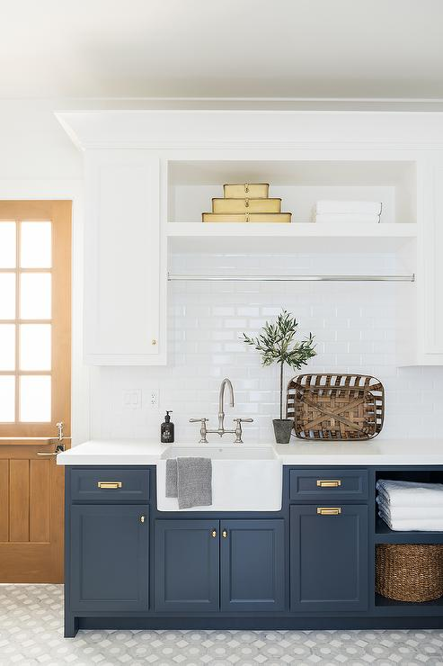 White And Blue Laundry Room With Farmhouse Sink Transitional Laundry Room