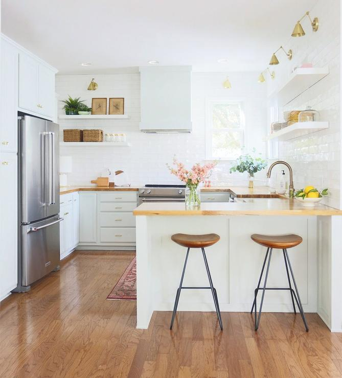White Kitchen With Light Wood Countertops