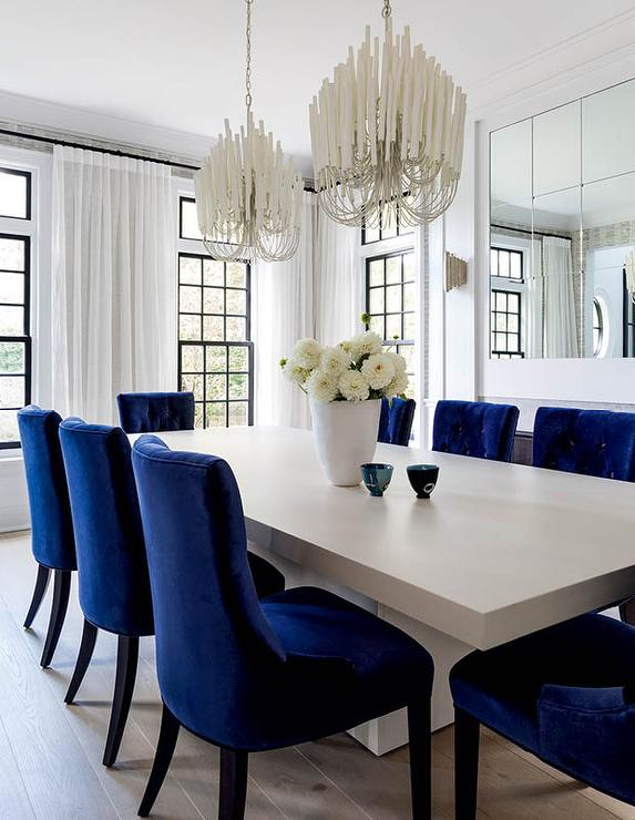 Two White Chandeliers Over Gray Wood, White Chandeliers For Dining Rooms