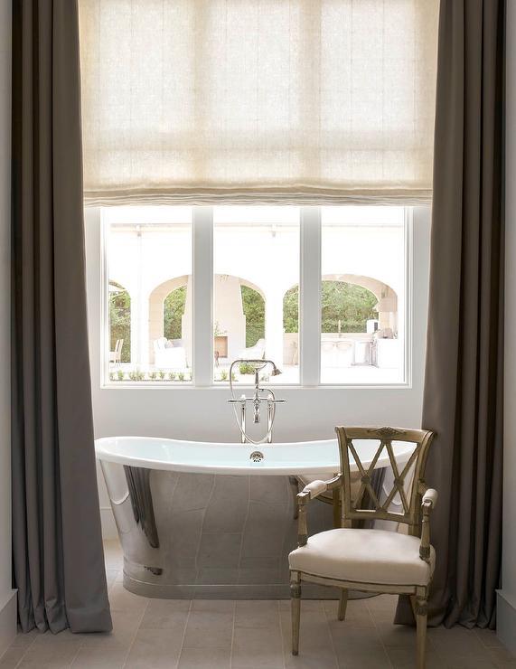 Cream Beaded Chandelier Over Bathtub Transitional Bathroom