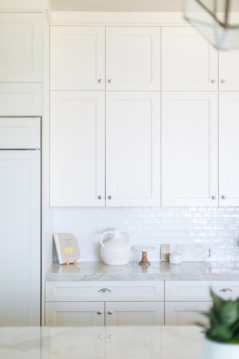 White Glazed Subway Tiles with Stacked White Shaker Cabinets ...